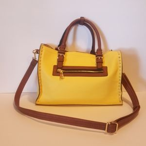 Handbags - A yellow handbag with handles and strap.